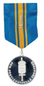 Försvarsmaktens förtjänstmedalj i silver med svärd.